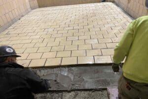 slanted tile floor on interior of tank