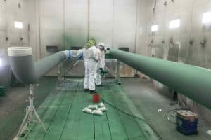 Large pipes being painted
