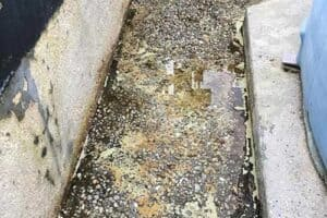 corroded concrete containment area