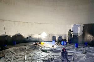 interior of a carbon steel tank being relined