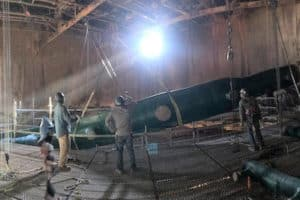 a large fiberglass pipe being lifted